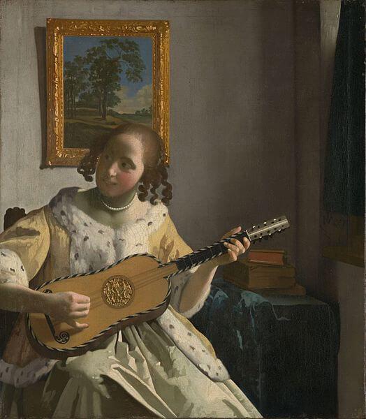 Jan Vermeer: Koven tocando guitarra